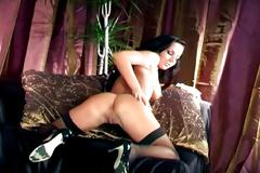 Glamour babe masturbating in thigh high stockings