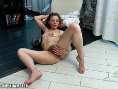 Erika rubs her hairy pussy to cum