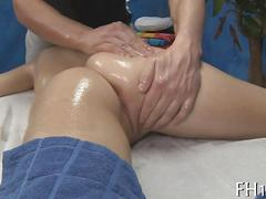 Busty chick gets fucked in a massage parlor after oiling up