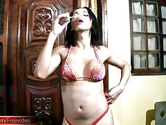 Shemale in bikini is blowing soap bubbles all naked