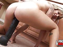 Payton ray has fun with a dildo in the kitchen