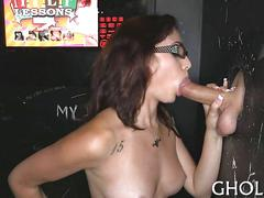Bitch blowing some dick in the gloryhole booth
