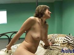 Slutty brunette masturbates with a dildo