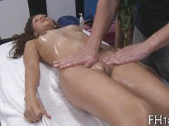 Shaved hottie of ethnic background gets fucked on a massage table