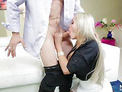 Big tit blonde lady sucking a big cock
