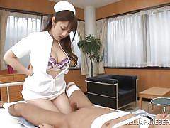 Japanese nurse playing with a patient's cock