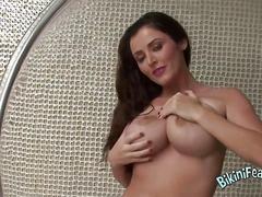 Dirty busty brunette in a bikini