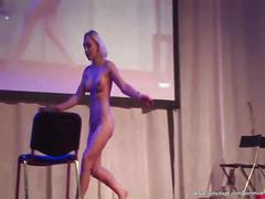 Sexy blonde milf fucks big dildo on the stage
