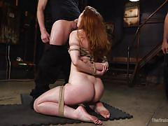Redhead slave in shibari sucks cock