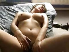 Spectacled mature strips and makes herself very wet