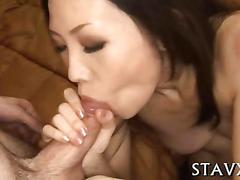 Japanese chick on her knees gobbling up a cock in pov