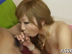 Asian porn star sucks dick and gets toyed in the ass