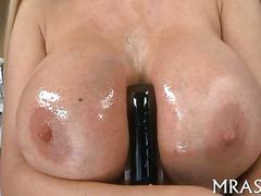 Blonde porn star with fake tits stuffs her ass with toys