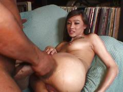 Young asian gets her tight slit fucked by black dong