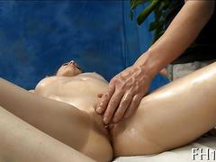 Hot gal gets her tits teased and pussy fucked during massage