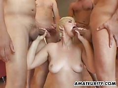 Blonde amateur sucking cock in gangbang