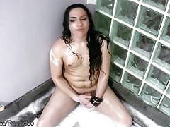 Gorgeous black haired tranny gets naked and masturbates