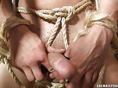 Tattooed guy tied and fucked by three punishers