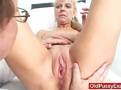 Mature blonde gets her pussy examined