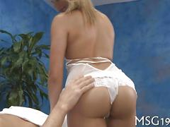 Blonde babe in short dress teasing client and fucking on massage table