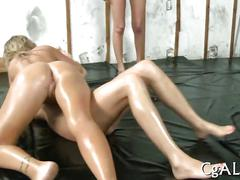 Hazed college girls oiled for wrestling and face riding strapon action
