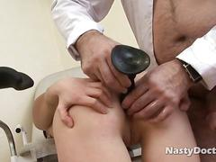 Nasty doctor examines brunettes arse