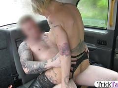 Busty tattooed blonde babe gets pussy nailed in the cab
