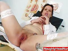 Mature amateur examines her pussy