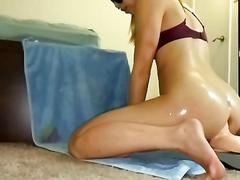Asian gf oiled up and rides 10in toy balls deep anally