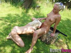 Busty blonde licks pussy