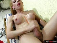 Blonde shemale with pigtails smears syrup on her shecock