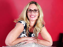 Blonde milf in glasses undressing and masturbating
