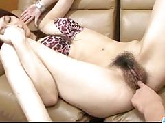 Finger fucking her hairy pussy