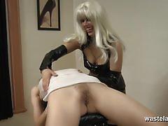 Lesbian dominatrix finger fucks her slave girls pussyhole
