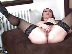 Horny brunette milf masturbating on the pouffe