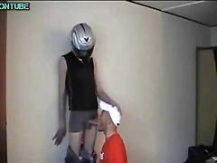 Sucking off the dude who has a nice shiny helmet