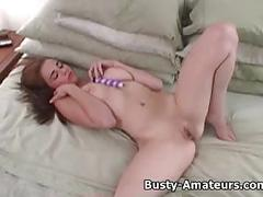 Busty holly sucking her own tits and masturbates her pussy