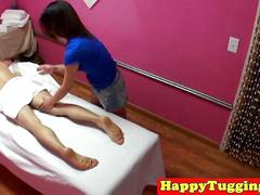 Skinny asian masseuse jerking and sucking guy