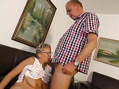 Mature couple fucking on the sofa
