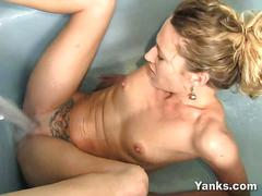 Blonde amberly masturbating in the bath