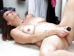 Shaved mature masturbates with toys on maturenl