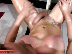 Feminine shemale beauty strokes her oiled up ladystick