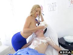 Big tits doctor fawx rides her young patients hard cock