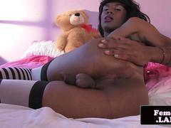 Black femboy masturbates in lingerie