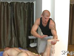 Tattooed bald masseur oils up hot guy for ass fucking