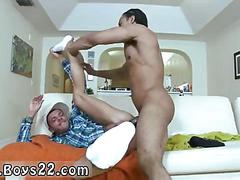 Hot black hunk spoon fucking a tattooed white guy on couch