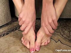 Sexy capri cavanni plays with her pretty feet