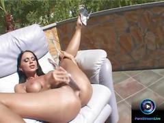 Enchanting christina bella sits on the sofa to use her long dildo
