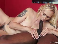 Mature blonde with a hairy pussy getting drilled by a black man
