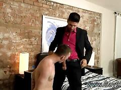 Two stylish gay men tease each other and ass fuck in bed